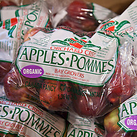 Bags of organic apples.