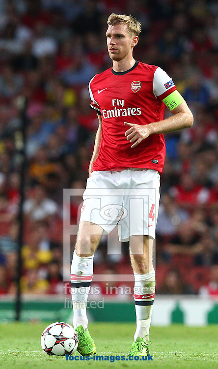 Picture by Paul Terry/Focus Images Ltd +44 7545 642257<br /> 27/08/2013<br /> Per Mertesacker of Arsenal during the UEFA Champions League match at the Emirates Stadium, London.