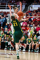 February 26, 2011; Stanford, CA, USA;  Stanford Cardinal guard Toni Kokenis (back) is fouled by Oregon Ducks guard/forward Victoria Kenyon (21) during the first half at Maples Pavilion.