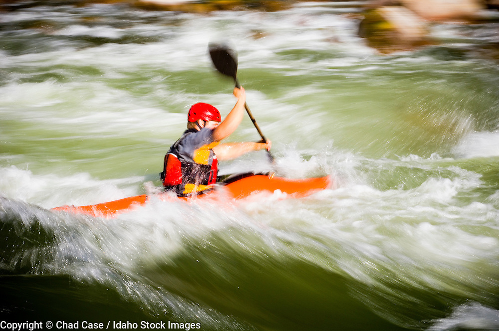 Idaho. South Fork Payette River. White water kayaker with motion blur. MR
