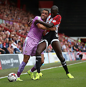 Wrestling or football? Things got a bit heated in the first half during the Sky Bet Championship match between Brentford and Reading at Griffin Park, London, England on 29 August 2015. Photo by Matthew Redman.