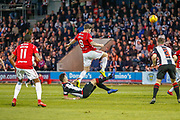 Mihai Popescu of St Mirren goes to ground to clear the ball during the Ladbrokes Scottish Premiership match between St Mirren and Hamilton Academical FC at the Paisley 2021 Stadium, St Mirren, Scotland on 13 May 2019.