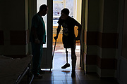 After loosing his right leg to a mortar round landing next to him in July 2016, Oleksandr Pivnev, 20, is undergoing rehabilitation practises at the 'Ukrainian Scientific Experimental Institute for Prostheses and Rehabilitation' in Kharvik, the country's second-largest city, in the east. He was wounded after only three months of serving in the army. He took the oath at 17 and now wishes to return active in the army and work as an instructor for younger soldiers.