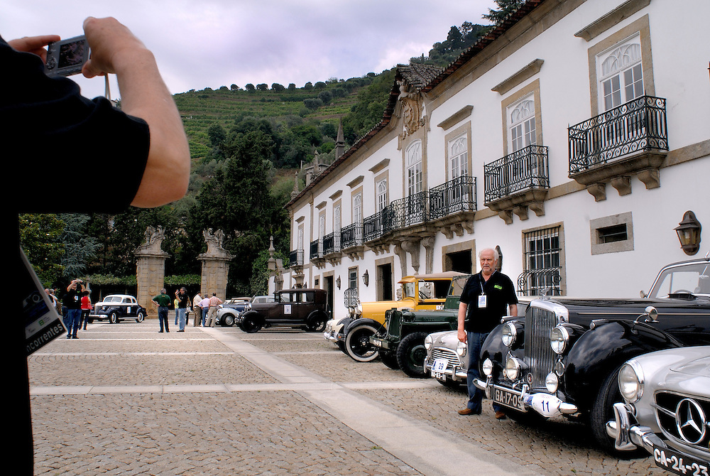 Solar da Rede, Mesao Frio, Portugal -A guest poses among classic cars outside the  Pousada Solar da Rede, an 18th century quinta with vineyards. The cars were part of a lunch at the pousadas for their Portuguese classic car club...photo by Susana Raab