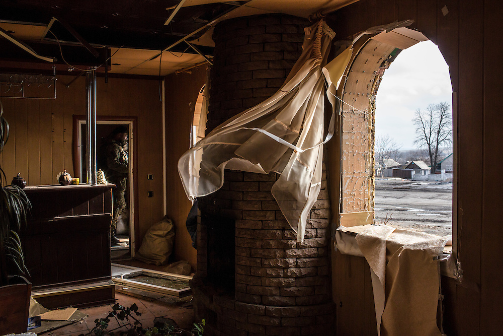 DEBALTSEVE, UKRAINE - FEBRUARY 8, 2015: A building damaged by fighting that is used by Ukrainian fighters in Debaltseve, Ukraine. Fighting between pro-Russia rebels and Ukrainian forces there over the past two weeks has dealt steady casualties to Ukrainian fighters and civilians. CREDIT: Brendan Hoffman for The New York Times