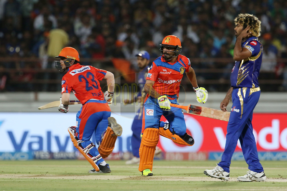 Ravindra Jadeja of the Gujarat Lions and Ishan Kishan of the Gujarat Lions takes a run during match 35 of the Vivo 2017 Indian Premier League between the Gujarat Lions and the Mumbai Indians  held at the Saurashtra Cricket Association Stadium in Rajkot, India on the 29th April 2017<br /> <br /> Photo by Vipin Pawar - Sportzpics - IPL