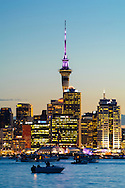 Auckland city at dusk, taken from Northshore. New Zealand