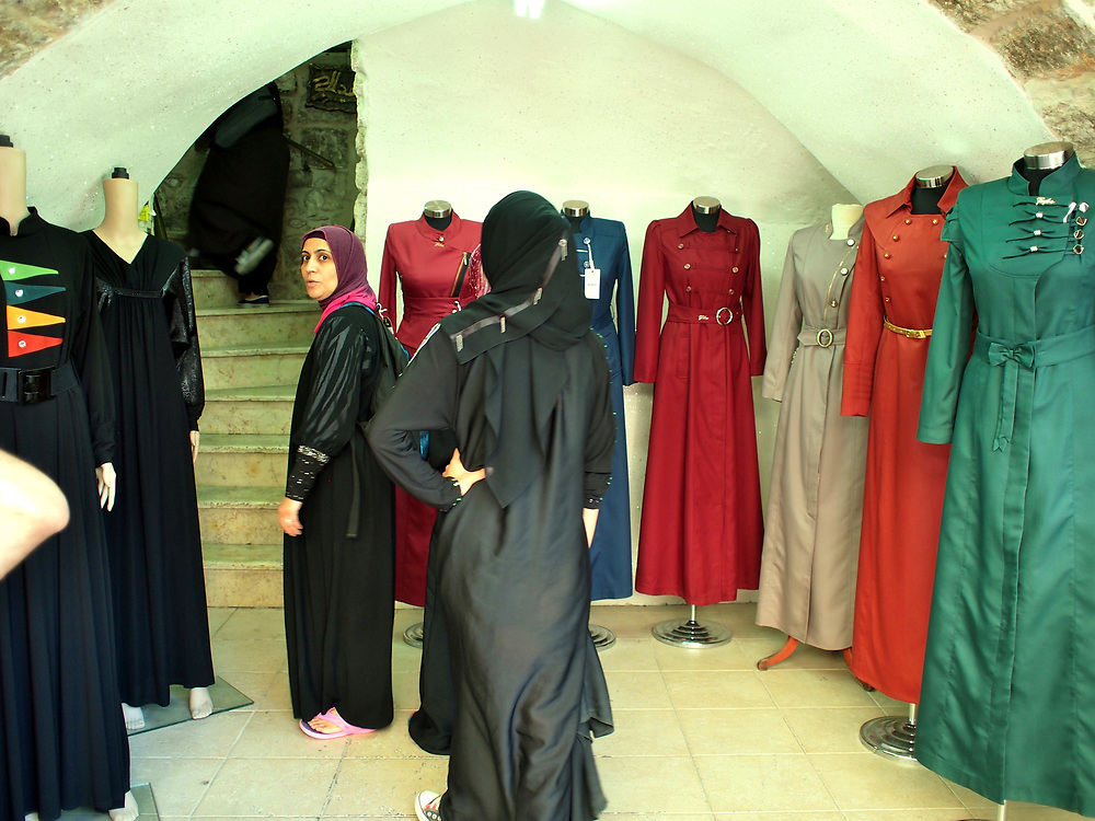 Woman inside a dress shop in the Arab Quarter, Old City Jerusalem 2013.