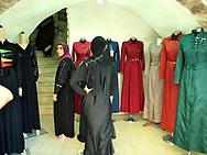 Woman inside a dress shop in the Arab Quarter, Old City Jerusalem 2013.