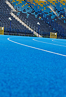 Photo of blue tracking field on stadium
