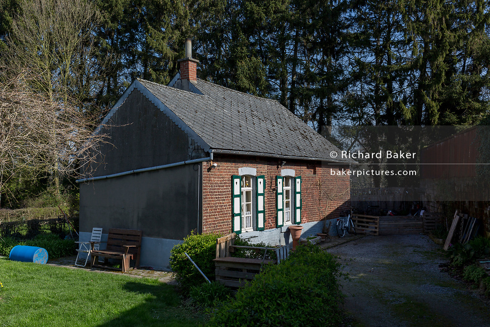 A traditional Flemish cottage and courtyard, on 25th March, in Everberg, Brabant, Belgium.