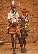 The football stars of tomorrow<br /> <br /> Thousands of Football shirts of Arsenal, Manchester, Chelsea, Milano, etc end up their carreer in... Ethiopia. Sold in the deep south, in the Omo Valley, those second hand clothes are bought by the local tribes. Most of them ignore the meaning of those shirts, and just buy them for the color, the logo, or the shape.<br /> No warrior will go out without his little pillow/seat.<br /> Some, like in Hamer tribe wear at the top of the head a clay helmet where they can put some ostrich feathers when they make a special action, like killing a wild animal, or...a man.<br /> Those tribes won't exist in few years as the ethiopian governement has launched a huge plan to develop the area.<br /> Soon, a highway coming from Mombassa - Nairobi will pass thru the villages to reach Addis Ababa.<br /> <br /> Photo shows: Hamer tribe- Manchester United<br /> ©Eric Lafforgue/Exclusivepix Media