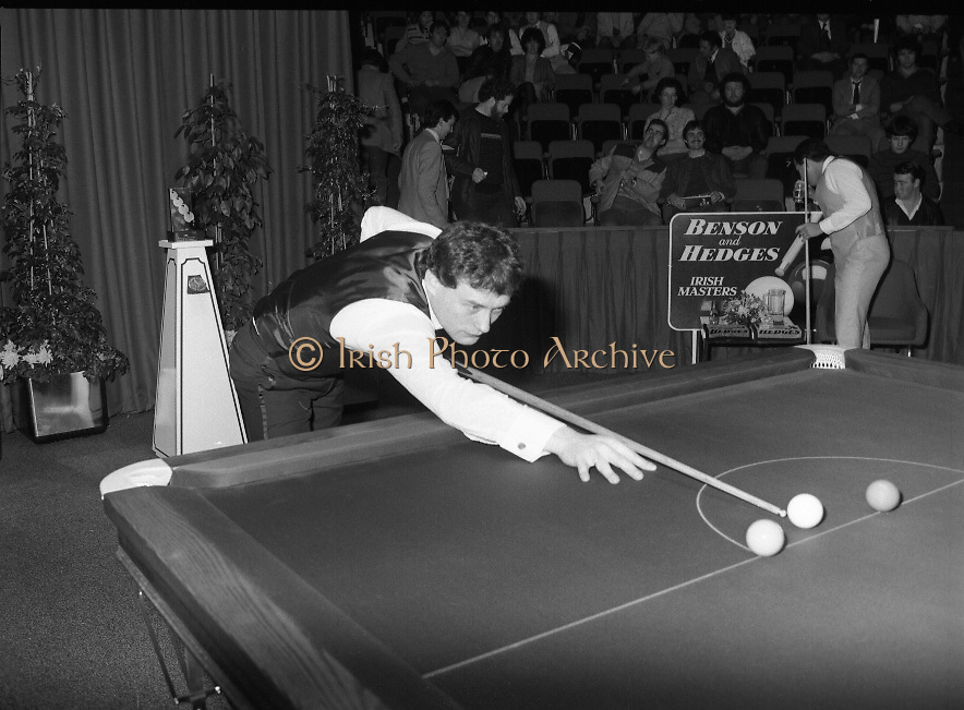 "The Benson and Hedges .Irish Masters Snooker..1984..28.03.1984..03.28.1984..28th March 1984..The championship was held at Goffs,Co Kildare. All the top names in snooker took part..Steve Davis,Jimmy White,Eddie Charlton,.Tony Knowles,Dennis Taylor,Tony Meo,.Alex Higgins,Ray Reardon,.Cliff Thorburn,Terry Griffiths,.Bill Werbeniuk and Eugene Hughes..The eventual winner was Steve Davis who beat Terry Griffiths 9 -1 in the final..Image as Jimmy White ""breaks"" to get the second frame underway, as Tony Meo gets a drink.."