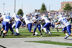 17 September 2011: Noah Martin prepares to hand off to running back Steve Rivera during an NCAA Division 3 football game between the Aurora Spartans and the Illinois Wesleyan Titans on Wilder Field inside Tucci Stadium in.Bloomington Illinois.