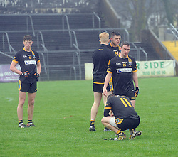 Louisburgh players disappointed at the end of their semi-final .<br />