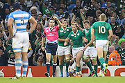 Luke Fitzgerald of Ireland is congratulated after scoring his teams first try during the Rugby World Cup Quarter Final match between Ireland and Argentina at Millennium Stadium, Cardiff, Wales on 18 October 2015. Photo by Shane Healey.