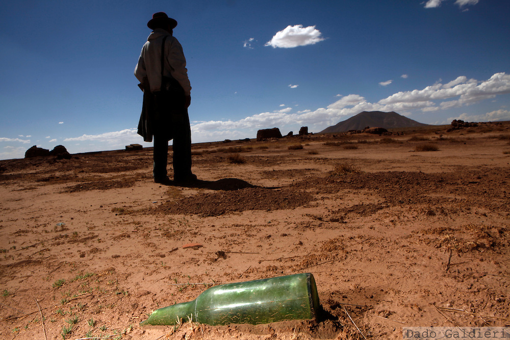 Jeronimo Valente, an Aymara Indian, checks the former lands of his father, expropriated and contaminated by a gold mine that left the country without compensation for contaminating the water and soil of this once farming land in the rural area of Chuquina, near  Oruro, Bolivia, Friday, Sept. 25, 2009. Bolivia's Indian majority has been emboldened by a new constitution that says their traditional, communally held lands may not be exploited without consultation.