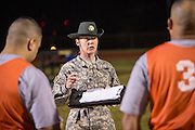 A female Drill Sergeant instructor with Drill Sergeant candidates at the US Army Drill Instructors School Fort Jackson during the entry physical training test early morning September 27, 2013 in Columbia, SC. While 14 percent of the Army is women soldiers there is a shortage of female Drill Sergeants.