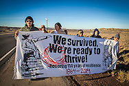 A group of Diné on the first day of a 200-mile walk through their ancestral homeland. The group's journey commemorated a forced walk their ancestors took away from the area 150 years ago. The raised awareness to the environmental degradation of Navaho land, culture and people in the four corners region where the fracking industry is booming.