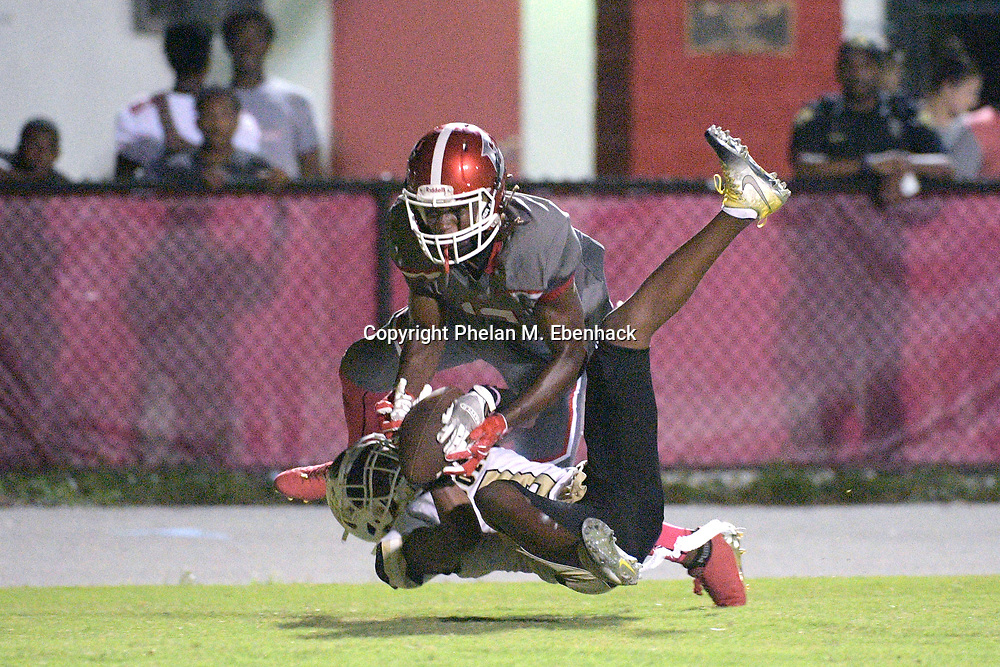 Ocoee's Kendall Bohler (3), bottom, attempts to intercept a pass intended for Edgewater receiver Jeremiah Chambers (13) in the end zone during the second half of a high school football game Monday, Oct. 9, 2017, in Orlando, Fla. The play was ruled an incompletion and Edgewater won 44-29. (Photo by Phelan M. Ebenhack)