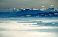 Breathtaking view across the misty Freiamt from Zufikon to Mount Pilatus and the Alps beyond.