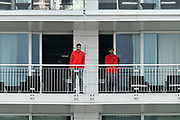 Southampton players Wesley Hoedt and Manolo Gabbiadini watching the cricket, before the match with Bournemouth, from the Hilton Hotel balcony during the second day of play in the Specsavers County Champ Div 1 match between Hampshire County Cricket Club and Essex County Cricket Club at the Ageas Bowl, Southampton, United Kingdom on 28 April 2018. Picture by Graham Hunt.