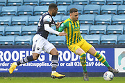 Millwall defender Mahlon Romeo (12) battles for possession with West Bromwich Albion forward Hal Robson-Kanu (4) during the EFL Sky Bet Championship match between Millwall and West Bromwich Albion at The Den, London, England on 9 February 2020.