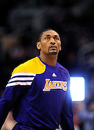 Feb. 19, 2012; Phoenix, AZ, USA;  Los Angeles Lakers forward Metta World Peace (15) reacts on the court while playing Phoenix Suns at the US Airways Center.  The Suns defeated the Lakers 102-90. Mandatory Credit: Jennifer Stewart-US PRESSWIRE.