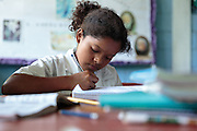 A girl works in her notebook during class at the primary school in the town of Coyolito, Honduras on Wednesday April 24, 2013.