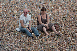 © Licensed to London News Pictures. 31/05/2014. Brighton, UK. A couple enjoy the early morning sun on Brighton Beach. The weekend is expected to reach temperatures of 20C down the South Coast according to the MET office. Photo credit : Hugo Michiels/LNP
