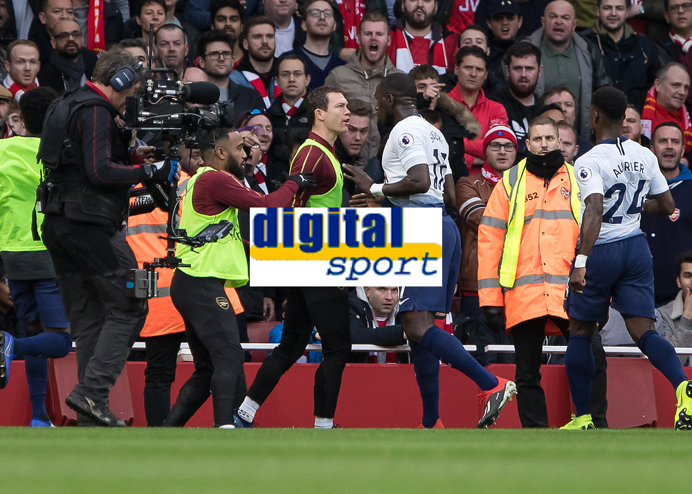 Football - 2018 / 2019 Premier League - Arsenal vs. Tottenham Hotspur<br /> <br /> Stephan Lichtsteiner (Arsenal FC) and Moussa Sissoko (Tottenham FC)  square upto each other at The Emirates.<br /> <br /> COLORSPORT/DANIEL BEARHAM