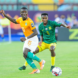 Max Gradel of Ivory Coast gets his pass away as he is challenged by Themba Zwane of South Africa during the 2019 Africa Cup of Nations Finals game between Ivory Coast and South Africa at Al Salam Stadium in Cairo, Egypt on 24 June 2019  <br /> Photo : Icon Sport