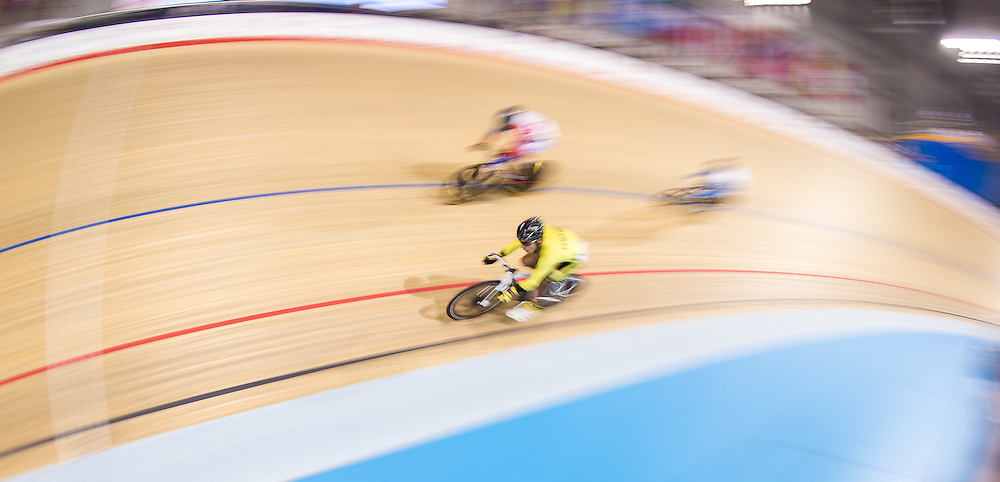 Jose Ragonessi Guzman (in yellow) of Ecuador competes in the Men's Omnium Scratch on the fist day of track cycling at the 2015 Pan American Games in Toronto, Canada, July 16,  2015.  AFP PHOTO/GEOFF ROBINS