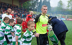 NEWTOWN, WALES - Saturday, May 2, 2015: The New Saints' captain Paul Harrison leads his side out to face Newtown before the FAW Welsh Cup final match at Latham Park. (Pic by Ian Cook/Propaganda)