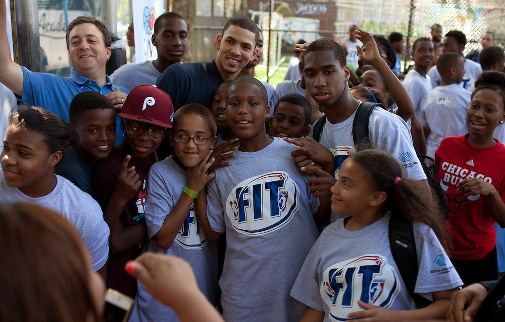 {June 27, 2012} {4:00pm} -- New York, NY, U.S.A.Duke basketball star Austin Rivers poses for photographs with kids after playing ball at the Dunlevy Milbank Boys & Girls Club in Harlem before the NBA draft Thursday in Manhattan, New York on June 27, 2012. .