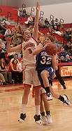Miamisburg's Chelsea LaPorte (32) goes for the basket, with Beavercreek's Mikaela Ruef (3) blocking at the Girls Division I sectional basketball finals, held at Troy High School, Saturday afternoon.