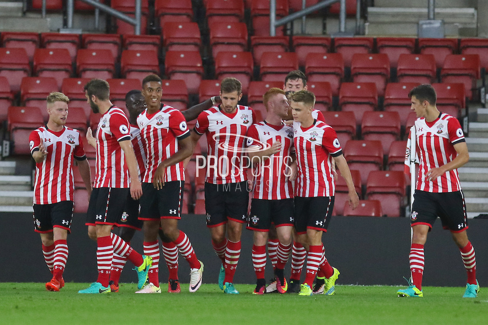 Southampton players celebrate Josh Sims of Southampton U23's goal 1-0 during the Under 23 Premier League 2 match between Southampton and Manchester United at St Mary's Stadium, Southampton, England on 22 August 2016. Photo by Phil Duncan.