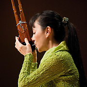 """February 18, 2012 - New York, NY : .Mayumi Miyata plays the mouth organ, or """"sho,"""" as she performs the World Premiere of Akiko Yamane's 'Dots Collection No. 13' (2012) with Fuyuhiko Sasaki (not pictured) during """"Resonances of the Kugo,"""" part of the 2012 New York Music From Japan Festival, at Merkin Concert Hall on Saturday. .CREDIT: Karsten Moran for The New York Times"""