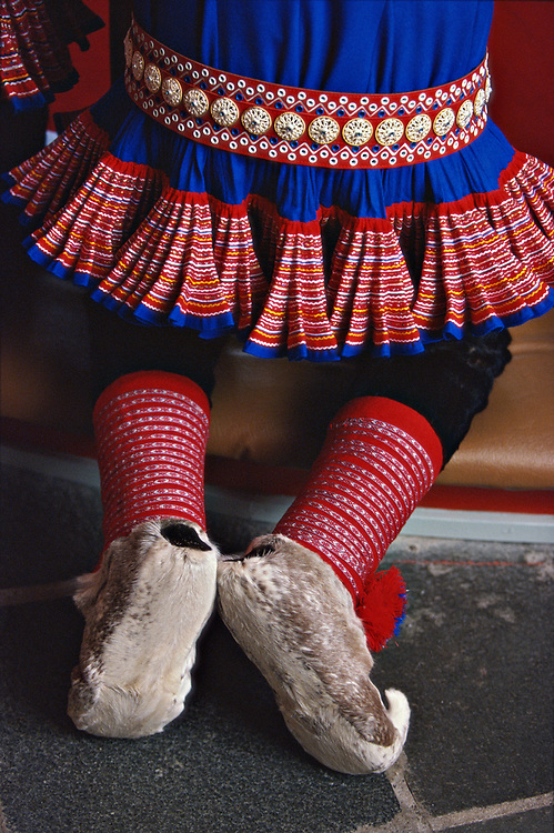 A Sami boy in traditional costume kneels by the altar at a confirmation ceremony in the church of Kautokeino, Norway.  The Sami living in Kautokeino hold confirmations and other life cycle ceremonies at Easter time, after which the reindeer herders move with their herds to the Atlantic coast for summer pasture. The traditional tunic is made of wool and the winter shoes and trousers of reindeer fur. The belt has silver decorations.