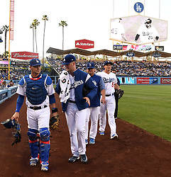 June 10, 2017 - Los Angeles, California, U.S. - Los Angeles Dodgers starting pitcher Alex Wood walks with catcher Yasmani Grandal along with pitching coach Rick Honeycutt and Corey Seager (5) prior to a Major League baseball game against the Cincinnati Reds at Dodger Stadium on Saturday, June 10, 2017 in Los Angeles. (Photo by Keith Birmingham, Pasadena Star-News/SCNG) (Credit Image: © San Gabriel Valley Tribune via ZUMA Wire)