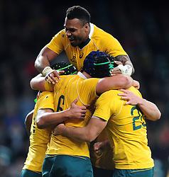 Dean Mumm of Australia celebrates his try with team-mates - Mandatory byline: Patrick Khachfe/JMP - 07966 386802 - 08/10/2016 - RUGBY UNION - Twickenham Stadium - London, England - Argentina v Australia - The Rugby Championship.