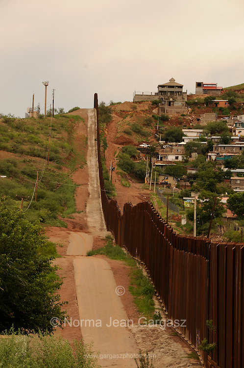 The border wall divides Nogales, Arizona, USA, (left), and Nogales, Sonora, Mexico.  At one time, the area was referred to as Ambos Nogales.