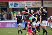 5th May 2018, Dens Park, Dundee, Scotland; Scottish Premier League football, Dundee versus Hamilton Academical; Goalscorer Kevin Holt of Dundee on the back of goalkeeper Elliott Parish at full time after the goalkeeper had saved a later penalty