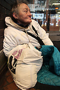 27 February 2013. New York, NY. A homeless woman sits in the doorway of the Port Authority Bus Terminal. Photograph by Sehar Mughal/CUNY Journalism Photo