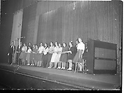 07/11/1959<br /> 11/07/1959<br /> 07 November 1959<br /> All Ireland Final of Gael Linn Children's Singing Competition at Francis  Xavier Hall, Dublin. Picture shows the twelve finalists singing with members of the Gael Linn Cabaret group onstage at the end of the competition.