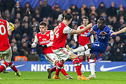 Chelsea midfielder N'golo Kanté (7) shoots towards the goal during the Premier League match between Chelsea and Arsenal at Stamford Bridge, London, England on 21 January 2020.