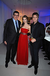 Left to right, JEAN-MARC LACAVE Chief Executive of Tag Heuer, DELTA GOODREM and BRIAN McFADDEN attending the Tag Heuer party where an exhibition of photographs by Mary McCartney celebrating 15 exception women from 15 countries was unveiled at the Royal College of Arts, Kensington Gore, London on 8th February 2007.<br />