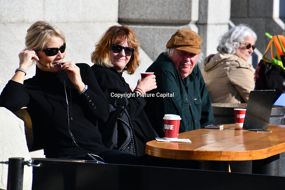People sitting at Trafalgar cafe in Trafalgar Square, London, UK 24 October 2018