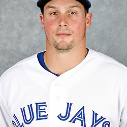 March 2, 2012; Dunedin, FL, USA; Toronto Blue Jays left fielder Travis Snider (45) poses for a portrait during photo day at Florida Auto Exchange Stadium.  Mandatory Credit: Derick E. Hingle-US PRESSWIRE