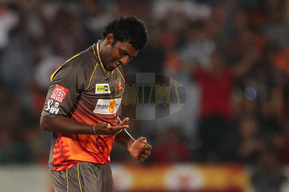 Thisara Perera examines his hand after he runs out Mitchell Marsh by touching the ball on to the stumps during match 3 of of the Pepsi Indian Premier League between The Sunrisers Hyderabad and The Pune Warriors held at the Rajiv Gandhi International  Stadium, Hyderabad  on the 5th April 2013..Photo by Ron Gaunt-IPL-SPORTZPICS..Use of this image is subject to the terms and conditions as outlined by the BCCI. These terms can be found by following this link:..http://www.sportzpics.co.za/image/I0000SoRagM2cIEc